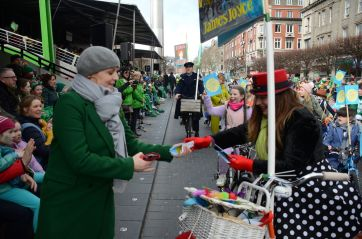Joyce-Cycle handing poems over at presidents stand St. Patrick's festival